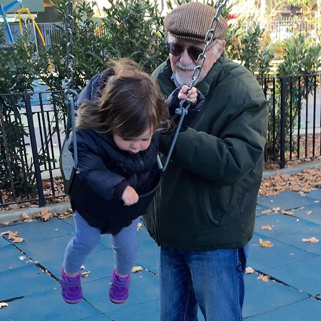 Alice and her 'Papa' swinging in NYC... Hats and gloves proved to be a tough sell to a California toddler. Off off OFF!..